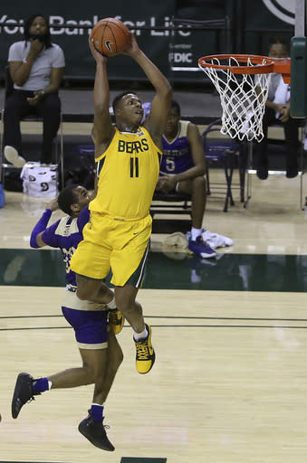 Baylor guard Mark Vital (11) scores past Alcorn State guard Byron Joshua (30) in the first half of an NCAA college basketball game, Wednesday, Dec. 30, 2020, in Waco, Texas. (AP Photo/ Jerry Larson)