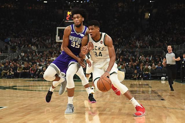 MILWAUKEE, WI - NOVEMBER 04: Giannis Antetokounmpo #34 of the Milwaukee Bucks works against Marvin Bagley III #35 of the Sacramento Kings during the first half of a game at the Fiserv Forum on November 4, 2018 in Milwaukee, Wisconsin. (Photo by Stacy Revere/Getty Images)