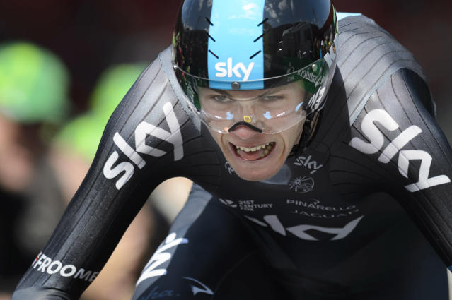 Winner of the 68th Tour de Romandie British Christopher Froome of team Sky Procycling, competes during the 5th and last stage, a 18,5 km race against the clock, at the 68th Tour de Romandie UCI ProTour cycling race, in the Stadium Maladiere in Neuchatel, Switzerland, Sunday, May 4, 2014. (AP Photo/Keystone, Laurent Gillieron)