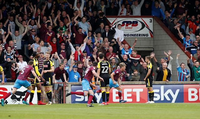 "Soccer Football - League One Play Off Semi Final First Leg - Scunthorpe United v Rotherham United - Glanford Park, Scunthorpe, Britain - May 12, 2018 Scunthorpe United's Cameron McGeehan celebrates after he scores his sides second goal Action Images/Craig Brough EDITORIAL USE ONLY. No use with unauthorized audio, video, data, fixture lists, club/league logos or ""live"" services. Online in-match use limited to 75 images, no video emulation. No use in betting, games or single club/league/player publications. Please contact your account representative for further details."