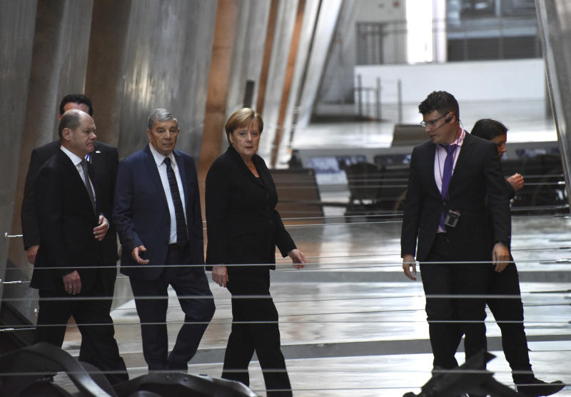 German Chancellor Angela Merkel, center, visits the Yad Vashem Holocaust Museum in Jerusalem, Israel, Thursday Oct. 4, 2018. (Debbie Hill/Pool via AP)
