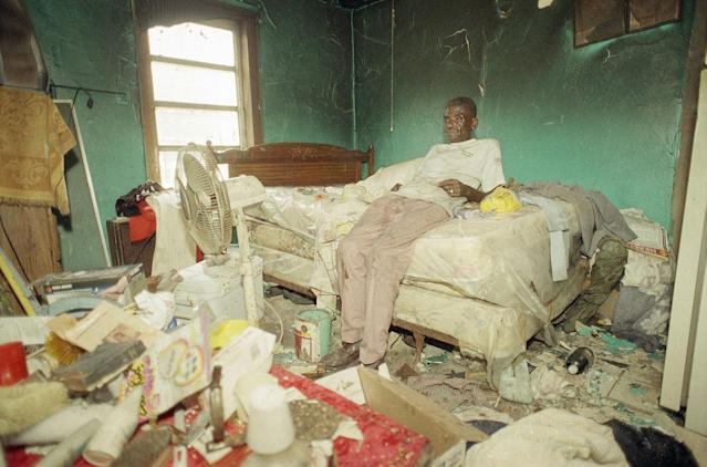 <p>Leroy Ferguson sits in the bedroom of his Homestead, Fla., home, the only room not destroyed in a fire caused by a kerosene lamp exploding, Sept. 11, 1992. Ferguson rode out Hurricane Andrew in this house built by his mother 67 years ago. (AP Photo/Doug Jennings) </p>