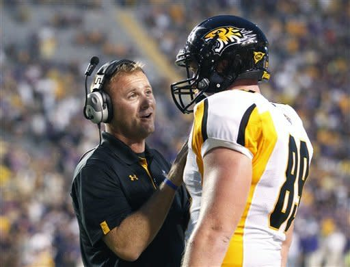 Towson coach Rob Ambrose talks with tight end Tanner Vallely (89) in the first half of an NCAA college football game against LSU in Baton Rouge, La., Saturday, Sept. 29, 2012. (AP Photo/Bill Haber)