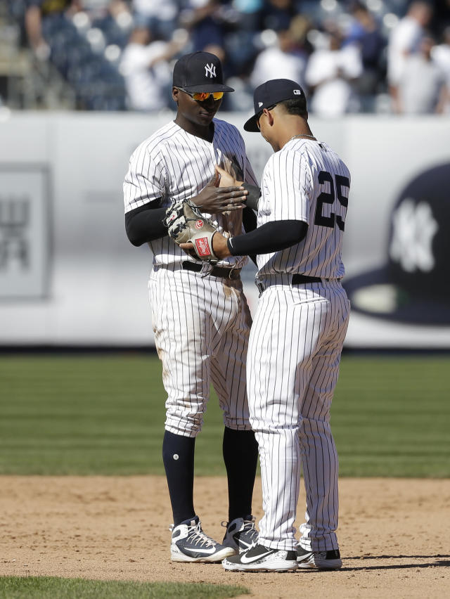 New York Yankees' Gleyber Torres, right, and Didi Gregorius celebrate after their baseball game against the Toronto Blue Jays at Yankee Stadium Sunday, April 22, 2018 in New York. The Yankees defeated the Blue Jays 5-1. (AP Photo/Seth Wenig)