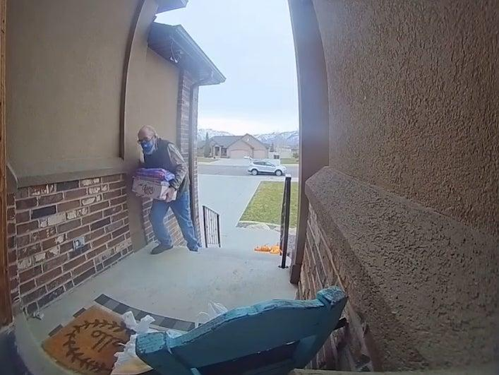 Jen Cantell Weiss shared footage on her Facebook earlier this month of the delivery driver struggling to walk up the steps to her home in Ogden, Utah (Jen Cantwell Weiss/ Facebook)