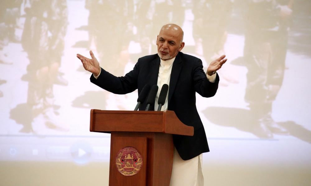 """<span class=""""element-image__caption"""">The Afghanistan president, Ashraf Ghani, addresses Afghan security forces in Kabul on Monday. He was excluded from and opposed to the US-Taliban deal.</span> <span class=""""element-image__credit"""">Photograph: Omar Sobhani/Reuters</span>"""