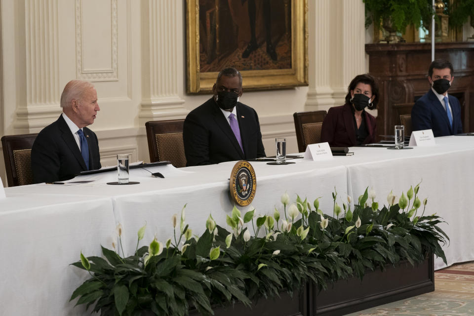 FILE - In this April 1, 2021, file photo President Joe Biden speaks during a Cabinet meeting in the East Room of the White House in Washington. From left, Biden, Secretary of Defense Lloyd Austin, Commerce Secretary Gina Raimondo, and Transportation Secretary Pete Buttigieg. Two months into his job, Buttigieg is forging a fresh path for his Cabinet role and in his life that could bridge gaps with Republicans when it comes to Biden's agenda. (AP Photo/Evan Vucci, File)
