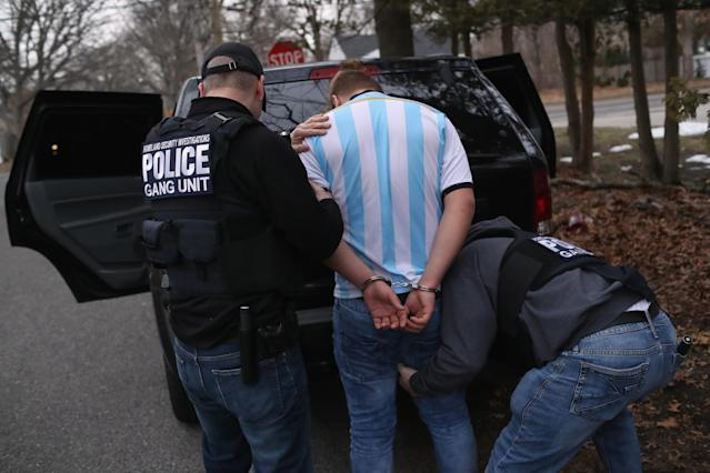ICE agents frisk a suspected MS-13 gang member after arresting him at his home on March 29, 2018, in Brentwood, N.Y. (Photo: John Moore/Getty Images)