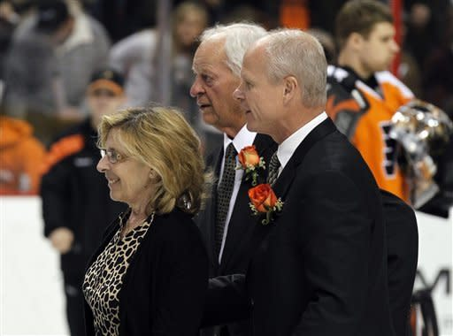 Ginger Howe, left, Gordie Howe and Mark Howe depart after a ceremony to retire NHL Hall of Famer Mark Howe's No. 2 jersey before an NHL hockey game between the Philadelphia Flyers and the Detroit Red Wings, Tuesday, March 6, 2012, in Philadelphia. (AP Photo/Alex Brandon)