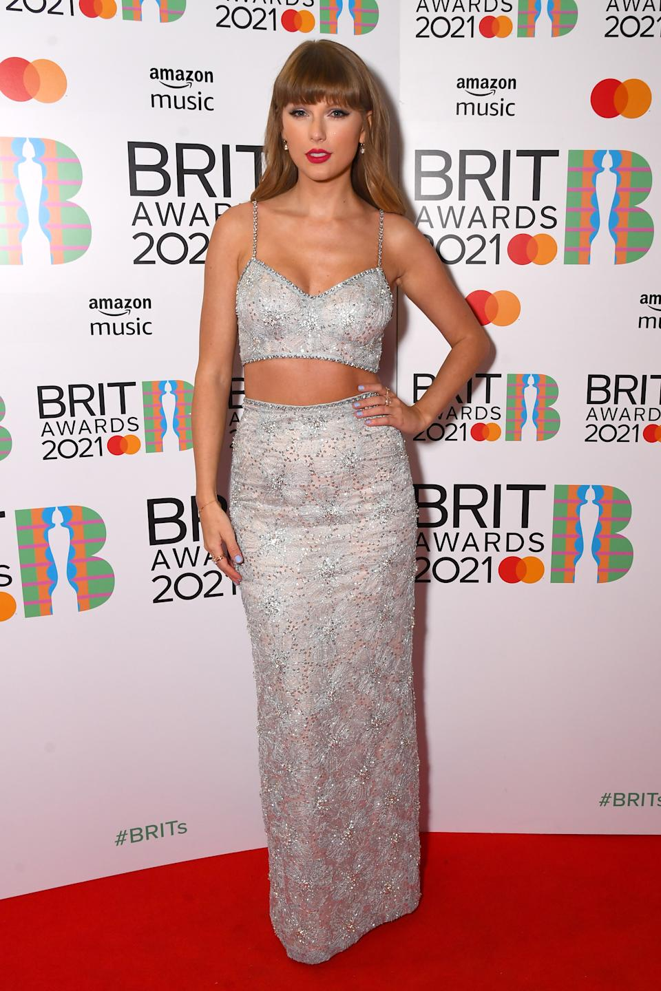 Taylor Swift poses backstage with the award for Global Icon during The BRIT Awards 2021 at The O2 Arena on May 11, 2021 in London, England