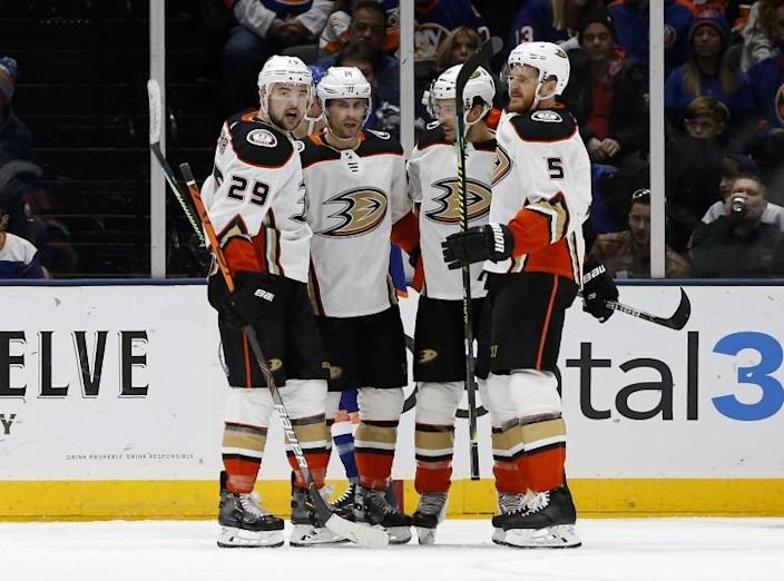 Anaheim Ducks center Adam Henrique (14) celebrates his goal against the New York Islanders with teammates Devin Shore (29), Michael Del Zotto (44) and Korbinian Holzer (5) during the second period of an NHL hockey game, Saturday, Dec. 21, 2019, in Uniondale, N.Y. (AP Photo/Jim McIsaac)