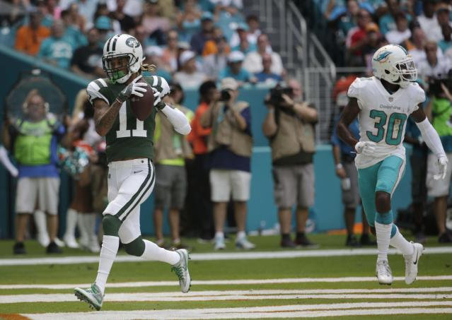 New York Jets wide receiver Robby Anderson hauls in a Josh McCown touchdown pass in Miami before jumping into the stands. (AP)