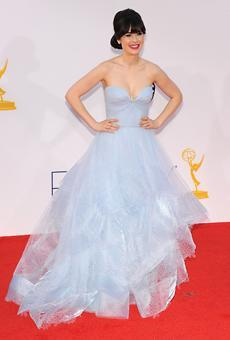 "<div class=""caption-credit""> Photo by: Getty Images</div><div class=""caption-title"">Zooey Deschanel</div><p> Fan favorite Zooey Deschanel made us soon in an icy blue Reem Acra gown with sweetheart neckline. Forevermark diamond studs and a Permier Gem for Forevermark ring added just the right amount of sparkle to an already spectacular wedding-worthy look. </p> <p> <i><a href=""http://www.brides.com/wedding-dresses-style/photos/blue?color=pink&primaryfacet=color?mbid=synd_yshine"" rel=""nofollow noopener"" target=""_blank"" data-ylk=""slk:Browse more pastel wedding dresses."" class=""link rapid-noclick-resp"">Browse more pastel wedding dresses.</a> <br> <br></i><b>Related: <a href=""http://www.brides.com/wedding-dresses-style/wedding-dresses/2012/07/lace-wedding-dresses-spring-2013?mbid=synd_yshine#slide=1"" rel=""nofollow noopener"" target=""_blank"" data-ylk=""slk:Modern Lace Wedding Dresses"" class=""link rapid-noclick-resp"">Modern Lace Wedding Dresses</a></b> <i><br></i> </p>"