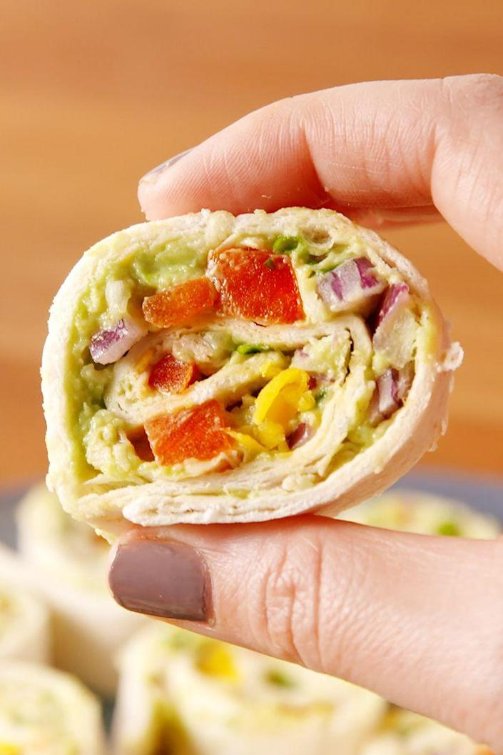 """<p>These chicken avocado salad pinwheels double as a nutritious snack and an adorable party appetizer.<br></p><p>Get the recipe from <a href=""""https://www.delish.com/cooking/recipes/a52540/chicken-avocado-roll-ups/"""" rel=""""nofollow noopener"""" target=""""_blank"""" data-ylk=""""slk:Delish"""" class=""""link rapid-noclick-resp"""">Delish</a>. </p>"""