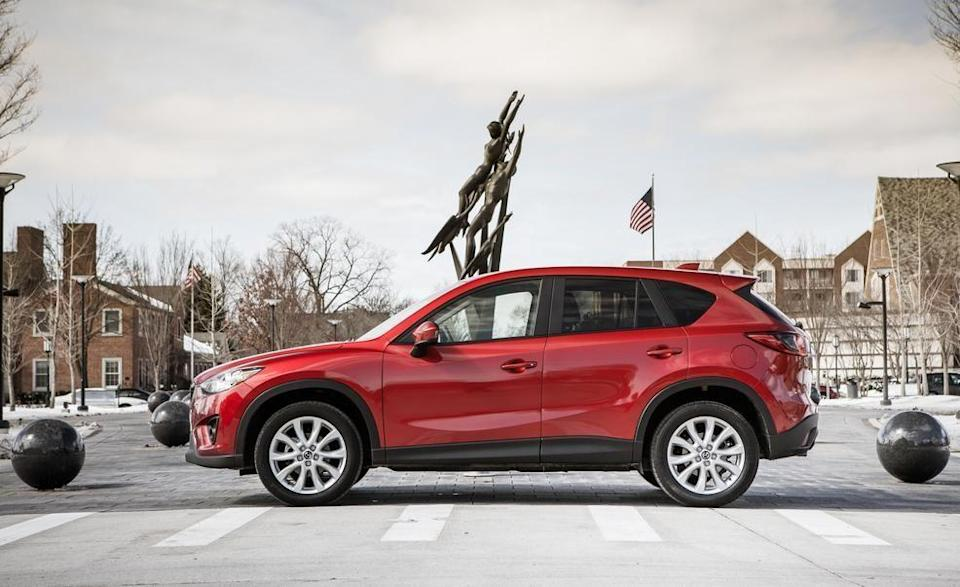 """<p>Mazda's compact crossover, the <a href=""""https://www.caranddriver.com/mazda/cx-5"""" rel=""""nofollow noopener"""" target=""""_blank"""" data-ylk=""""slk:CX-5"""" class=""""link rapid-noclick-resp"""">CX-5</a>, has only been around for two generations, and we've been fans since the beginning. The little SUV's first generation debuted in 2013 and ran until 2017, when the present design arrived. Both offer class-leading athleticism and driver enjoyment, well-crafted interiors, and smart styling. Even the older models still look good. The CX-5's design has always been more soccer player than soccer mom. In the second half of 2016, the crossover got a few updates such as a backup camera, touchscreen audio system, and a navigation system, which became standard on the Touring and Grand Touring trim levels. Some first-gen CX-5s were sold with a 2.0-liter four-cylinder and a five-speed manual transmission, but they are unicorns. Most have a 2.5-liter and an automatic. They aren't muscle cars, but they're quick enough. All-wheel drive was optional. Prices start at a little more than $8000.</p>"""