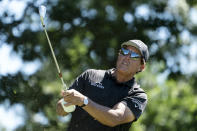 Phil Mickelson watches his shot off the 11th tee during the first round of the Travelers Championship golf tournament at TPC River Highlands, Thursday, June 24, 2021, in Cromwell, Conn. (AP Photo/John Minchillo)