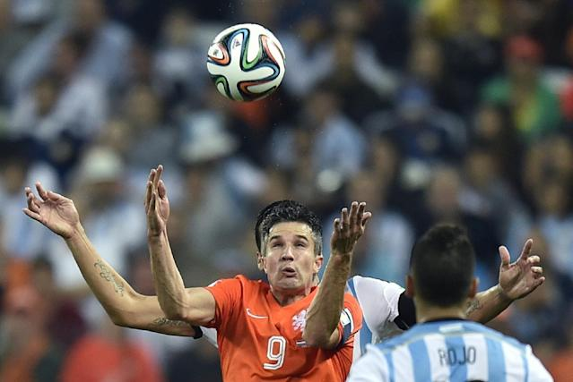 Netherlands' Robin van Persie eyes the ball during the World Cup semifinal soccer match between the Netherlands and Argentina at the Itaquerao Stadium in Sao Paulo Brazil, Wednesday, July 9, 2014. (AP Photo/Martin Meissner)