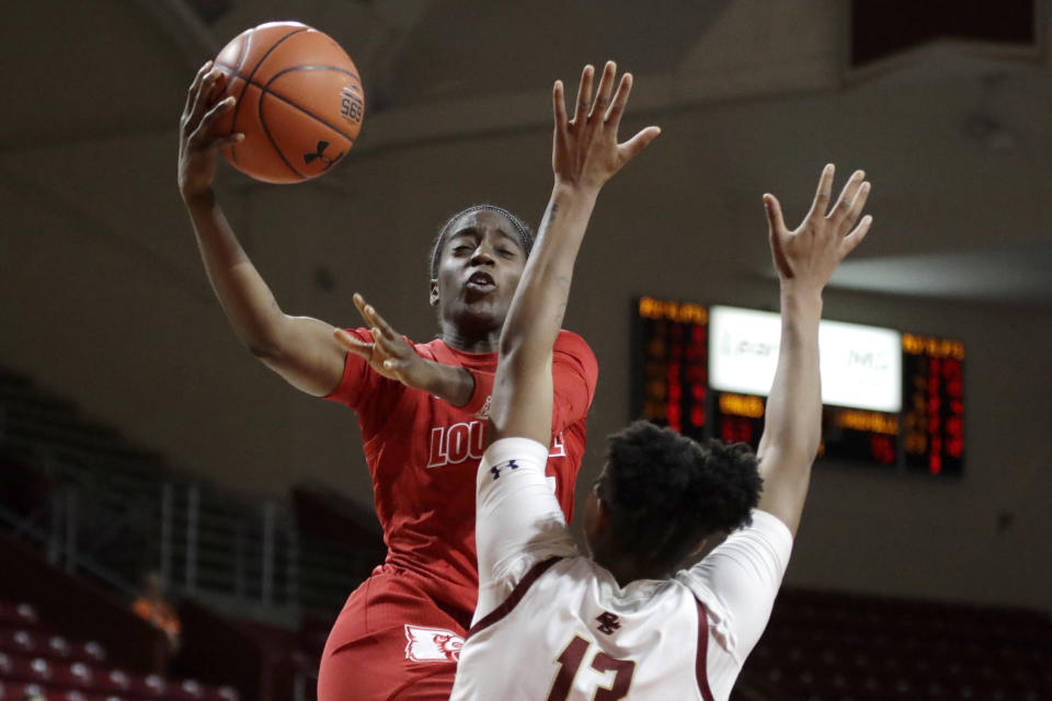 Louisville guard Jazmine Jones (23) is defended by Boston College forward Taylor Soule (13) during the second half of an NCAA college basketball game Thursday, Jan. 16, 2020, in Boston. (AP Photo/Elise Amendola)