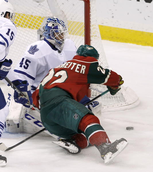 Minnesota Wild right wing Nino Niederreiter, right, of Switzerland, collides with Toronto Maple Leafs goalie Jonathan Bernier while chasing the puck during the first period of an NHL hockey game in St. Paul, Minn., Wednesday, Nov. 13, 2013. (AP Photo/Ann Heisenfelt)