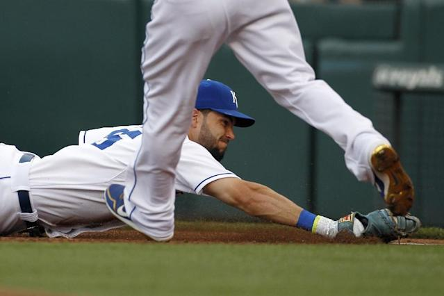 Kansas City Royals first baseman Eric Hosmer dives toward the bag after catching a ground ball hit by Los Angeles Dodgers' Andre Ethier in the second inning of a baseball game at Kauffman Stadium in Kansas City, Mo., Monday, June 23, 2014. Ethier was called out on the play. (AP Photo/Colin E. Braley)