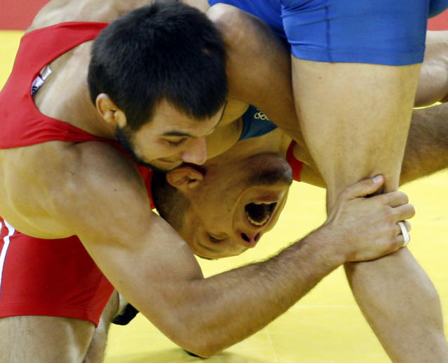Turkey's Ramazan Sahin, left, wrestles Ukraine's Andriy Stadnik during their 66 kilogram men's freestyle wrestling gold medal match at the Beijing 2008 Olympics in Beijing, Wednesday, Aug. 20, 2008. Sahin won the gold medal. (AP Photo/Ed Wray)