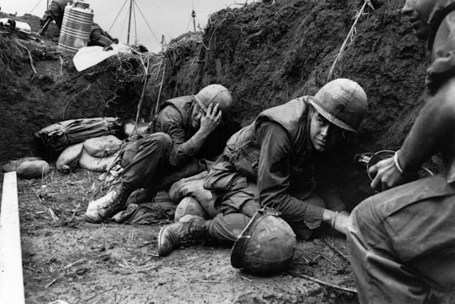 <p>US troops take cover from the Vietcong in a trench on Hill Timothy, during the Vietnam War. (Photo: Terry Fincher/Daily Express/Hulton Archive/Getty Images) </p>