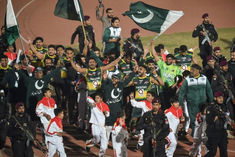 Pakistan's players celebrate after beating an Indian team in the final of the kabaddi World Cup