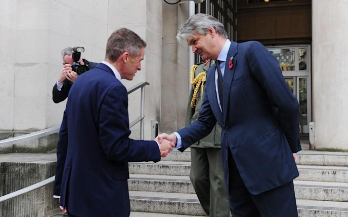 Stephen Lovegrove greets Gavin Williamson outside the Ministry of Defence in London - David Mirzoeff/PA Archive