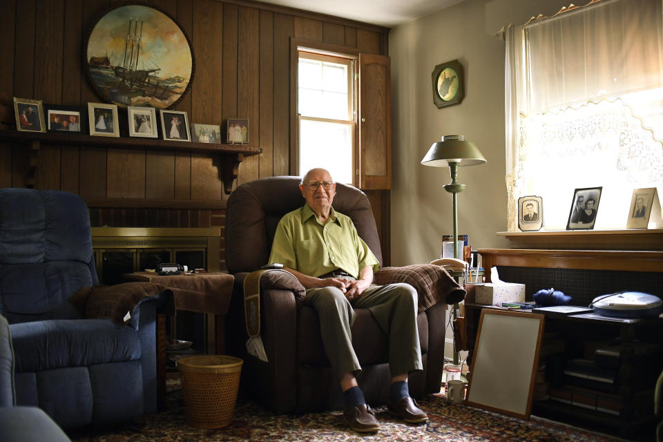 In this Saturday, July 17, 2021, photo, Fred Ware sits in his living room in Manchester, Conn. Ware and his son Dave recently found a whites-only covenant on his property dating back to 1942 when researching the title chain. Upon finding the covenant, Dave Ware, who grew up in the home, reached out to state lawmakers and helped get a bill passed that strips these covenants on properties. (AP Photo/Jessica Hill)