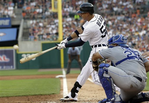 Detroit Tigers' Quintin Berry, left, connects for a two-run triple to deep center during the third inning of a baseball game against the Kansas City Royals in Detroit, Friday, July 6, 2012. (AP Photo/Carlos Osorio)