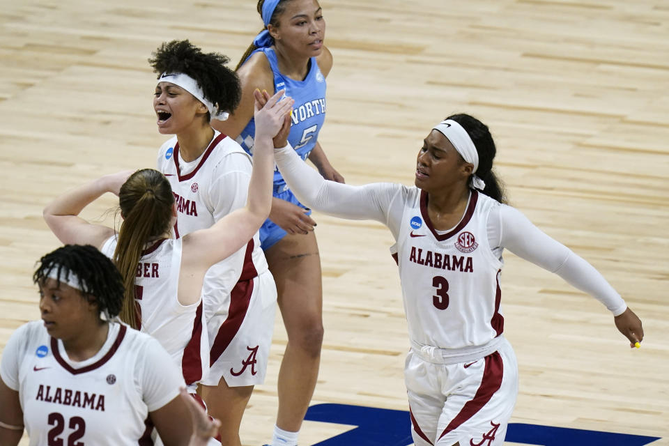 Alabama guard Jordan Lewis (3) celebrates with teammates during the second half of a college basketball game against North Carolina in the first round of the women's NCAA tournament at the Alamodome in San Antonio, Monday, March 22, 2021. (AP Photo/Eric Gay)