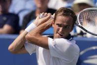 FILE - Daniil Medvedev, of Russia, returns a shot to Pablo Carreno Busta, of Spain, during the Western & Southern Open tennis tournament in Mason, Ohio, in this Friday, Aug. 20, 2021, file photo. Medvedev is seeded for the U.S. Open, the year's last Grand Slam tennis tournament. Play in the main draw begins in New York on Monday, Aug. 30. (AP Photo/Darron Cummings, File)