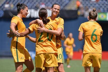 Jul 30, 2017; San Diego, CA, USA; Australia forward Sam Kerr (20) is congratulated by teammates Chloe Logarzo (6) and Emily van Egmond (10) and Emily Gielnik (15) after scoring a goal during the first half against Japan at Qualcomm Stadium. Mandatory Credit: Orlando Ramirez-USA TODAY Sports