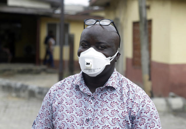 A man wearing a face mask outside Yaba Mainland hospital in Nigeria where an Italian citizen is being treated for coronavirus. Source: AP