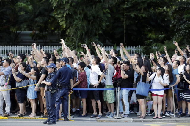 <p>Spectators gathered outside the Istana to witness the arrival of North Korean leader Kim Jong Un on Sunday (10 June) evening. (PHOTO: EFE/EPA) </p>