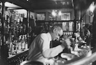 <p>A bartender taps a pint of beer at The Lamb, a pub in Bloomsbury, London. The traditional bar is still a popular spot that serves cask and craft beer, full-bodied wine, seasonal and nostalgic pub food.</p>