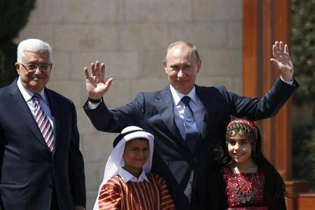 Palestinian President Abbas and Russian counterpart Putin stand with children during a welcoming ceremony in Bethlehem