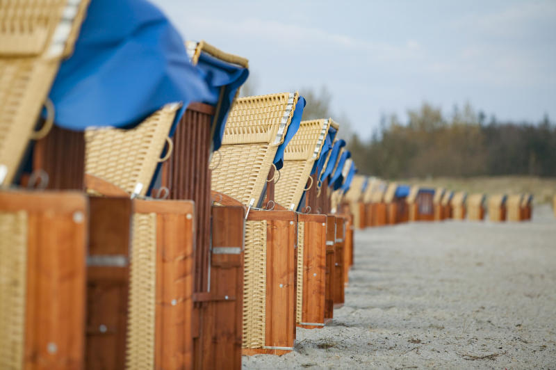 Row of beach chairs on a sandy beach