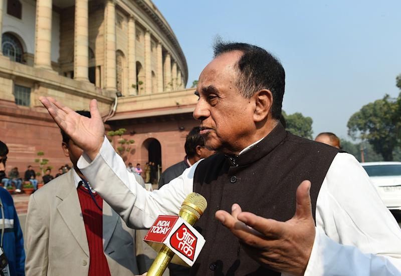 BJP leader Subramaniam Swamy interacts with members of the media at Parliament House in New Delhi on December 17, 2015.  (Photo: PRAKASH SINGH via Getty Images)