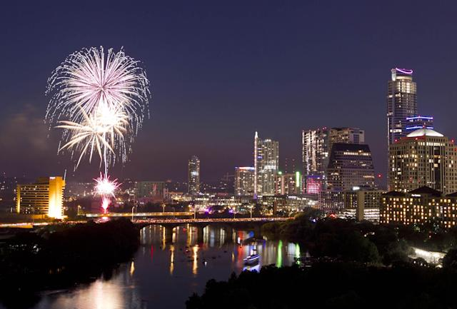 Fireworks explode over downtown Austin, Texas,on Thursday, July 4, 2013. (AP Photo/Austin American-Statesman, Jay Janner)