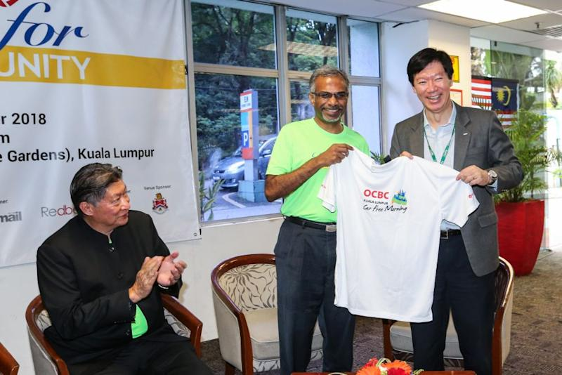OCBC Bank (Malaysia) Berhad CEO Datuk Ong Eng Bin (right) and K. Alan pose for the camera while Ancom Bhd executive chairman Datuk Siew Ka Wei looks on during the launching ceremony of Run for National Unity 2018 at HELP University August 23, 2018. — Picture by Ahmad Zamzahuri