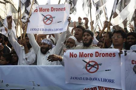 Supporters of the Jamaat-ud-Dawa Islamic organization hold placards and party flags as they shout slogans during a protest, against U.S. drone attacks in the Pakistani tribal region, in Lahore