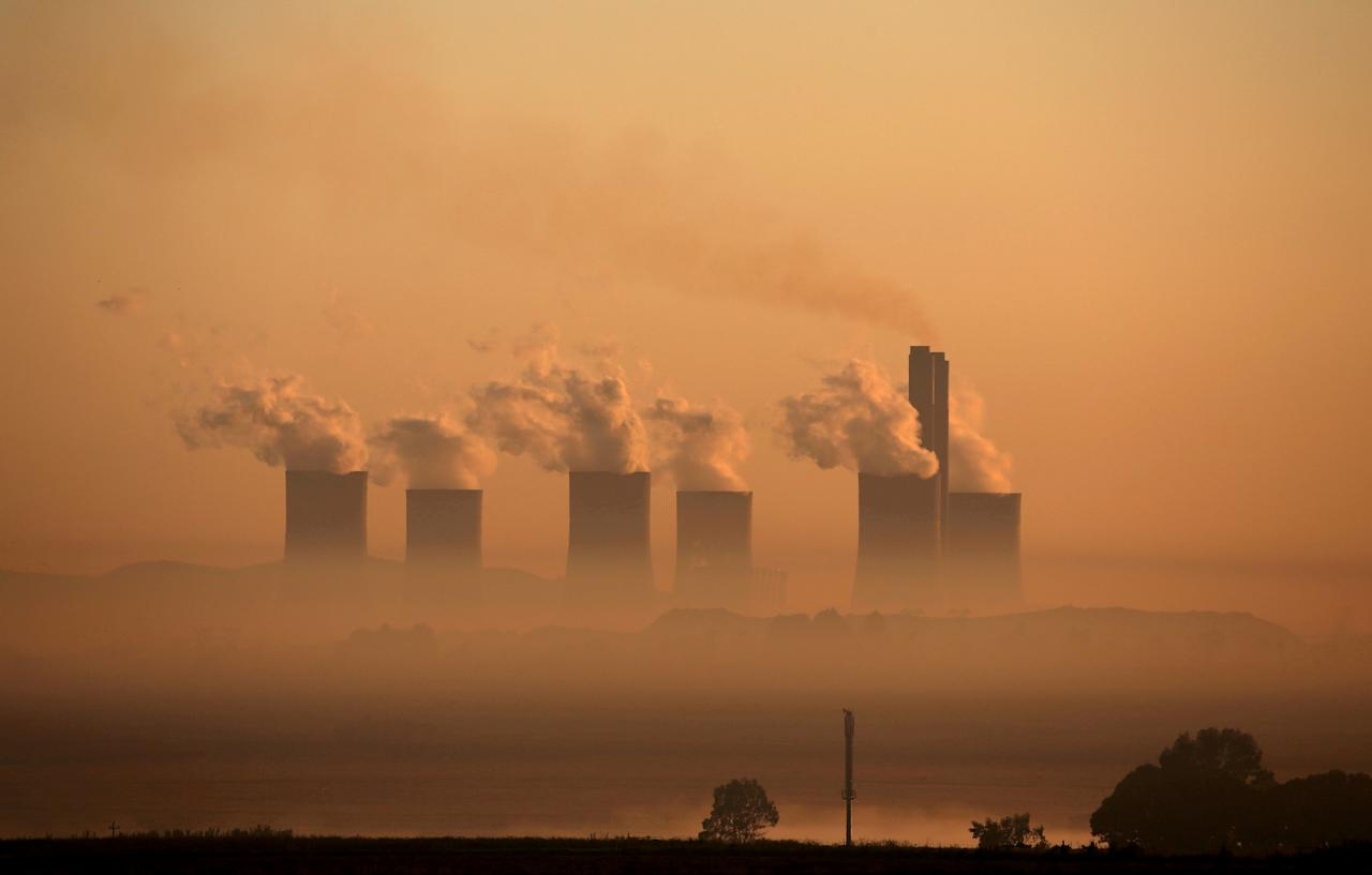 FILE PHOTO: Steam rises at sunrise from the  Lethabo Power Station, a coal-fired power station owned by state power utility ESKOM near Sasolburg, South Africa, March 2, 2016. Picture taken March 2, 2016. REUTERS/Siphiwe Sibeko/File Photo /File Photo/File Photo