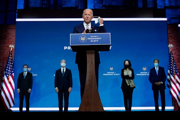 President-elect Joe Biden removes his face mask as he arrives to introduce his nominees and appointees to key national security and foreign policy posts at The Queen theater, Tuesday, Nov. 24, 2020, in Wilmington, Delaware.