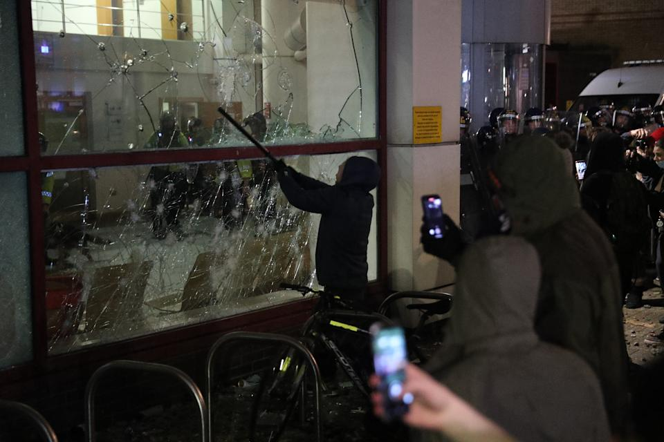 Protester smashes a Bridewell Police Station window as they take part in a 'Kill the Bill' protest in Bristol, demonstrating against the Government's controversial Police and Crime Bill. Picture date: Sunday March 21, 2021. (Photo by Andrew Matthews/PA Images via Getty Images)