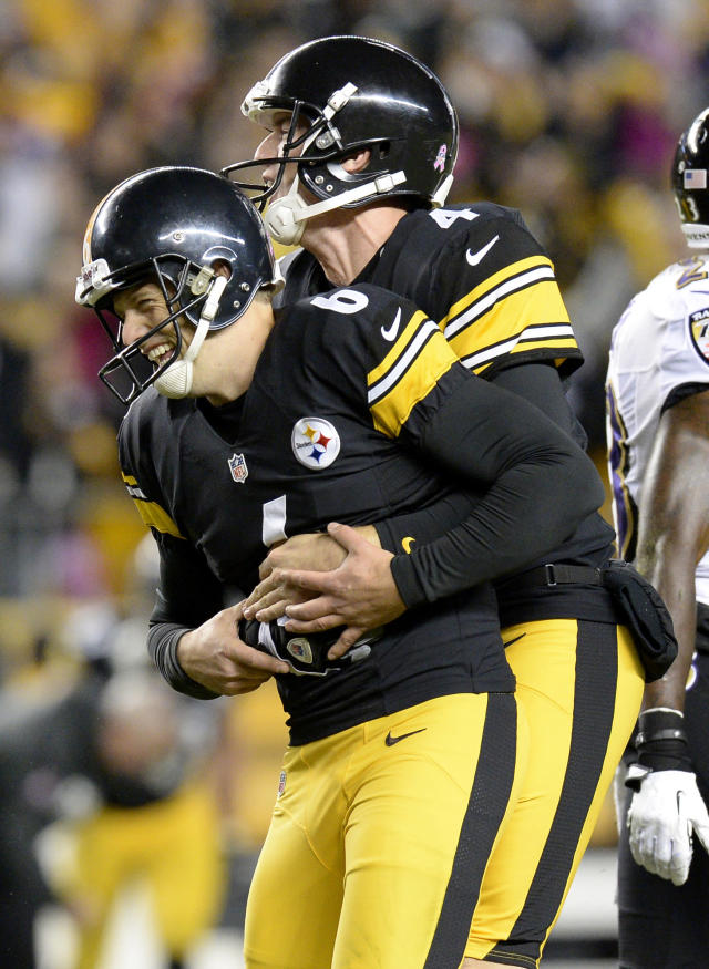 Pittsburgh Steelers holder Zoltan Mesko, right, celebrates with kicker Shaun Suisham after Suisham kicks the winning field goal against the Baltimore Ravens in the fourth quarter of an NFL football game on Sunday, Oct. 20, 2013, in Pittsburgh. The Steelers won 19-16. (AP Photo/Don Wright)
