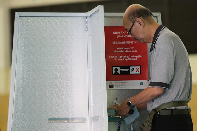 SINGAPORE - SEPTEMBER 11: A resident casts his vote at a polling station on September 11, 2015 in Singapore. About 2.5 million voters are expected to visit polling station islandwide. The 2015 general election sees all 89 parliamentary seats being contested for the first time since independence in 1965. This is also the first election in Singapore's history without founding Prime Minister, Lee Kuan Yew, who passed away in March this year. (Photo by Suhaimi Abdullah/Getty Images)