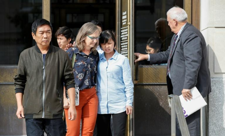 Ronggao Zhang (L) and Lifeng Ye (2R), the parents of victim Yingying Zhang, leave the federal courthouse in Peoria, Illinois after the first day of sentencing for Brendt Christensen on July 8, 2019
