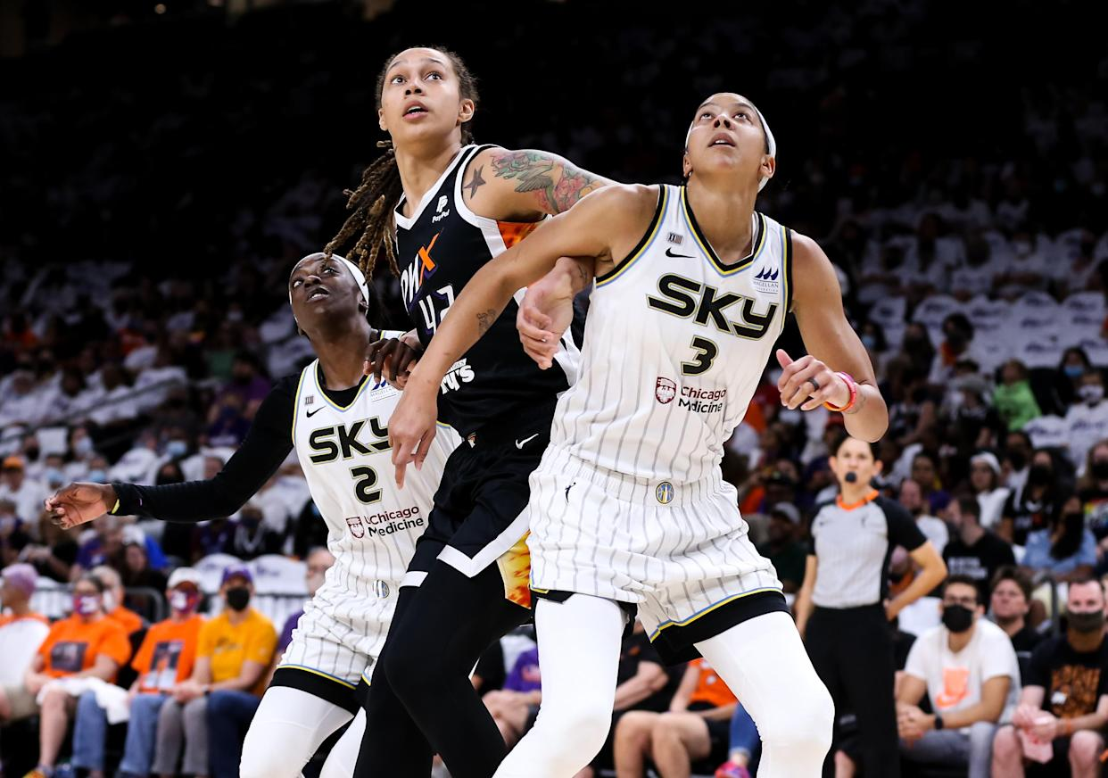 Kahleah Copper (2) of the Chicago Sky, Brittney Griner (42) of the Phoenix Mercury and Candace Parker (3) of the Sky battle for a rebound in Game 1 of the WNBA Finals. (Photo by Mike Mattina/Getty Images)