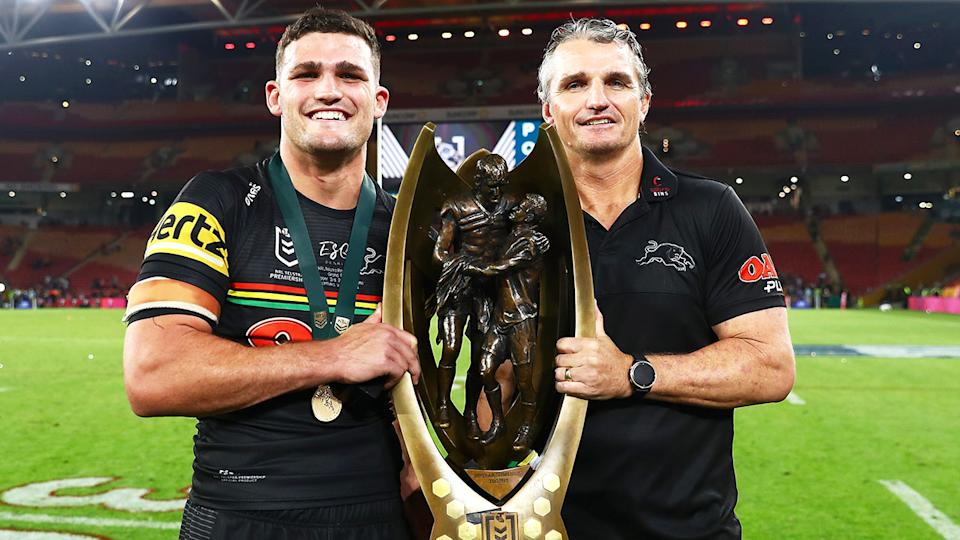 Penrith's Nathan and Ivan Cleary are seen here holding the NRL premiership trophy.